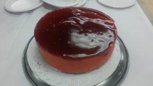 a raspberry entremet cake