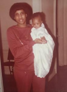 blog author neffi holding infant