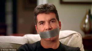 a man (Simon Cowell) with duct tape over his mouth
