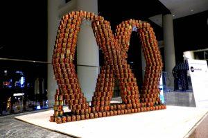 a Canstruction Sculpture of a pretzel
