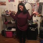 Blog author neffi in burgundy tunic and black pants