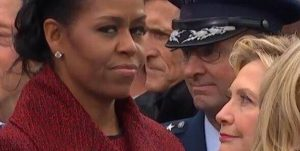 ex first lady michelle obama giving a side stare