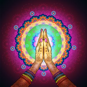 praying hands with mandala design in background