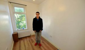 Man standing in small empty room