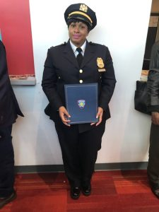 woman graduating in police force