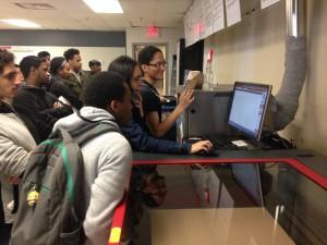 Franklin demonstrating Laser to students