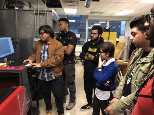 Heraldi Demonstrates Laser Cutting to Derric, Jonathan, Maria, Daniel, Joshua